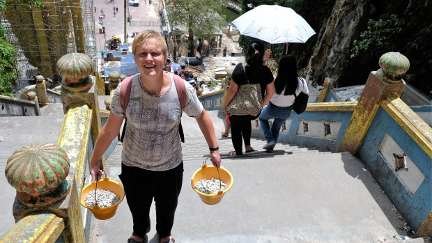 nick-carrying-buckets-of-rocks-to-batu-caves