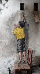 boy-on-chair-street-art