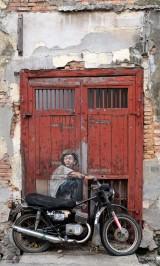 boy-on-motorbike-street-art
