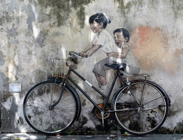 brother-and-sister-on-bicycle-street-art