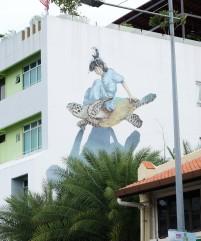 girl-ringing-turtle-street-art