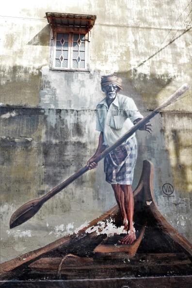 man-in-boat-street-art