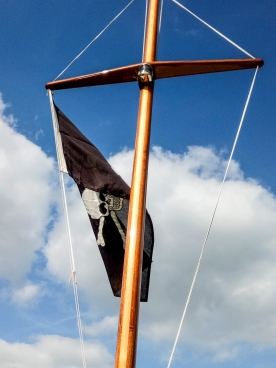 Pirate flag at full mast on the Thames